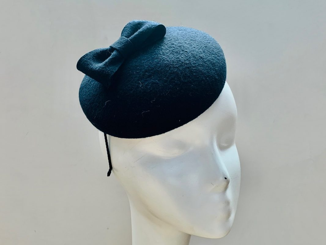 Ladies navy winter hats and fascinators