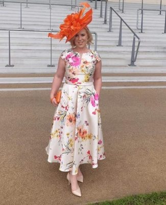 Orange ladies hatinator for the races or a wedding